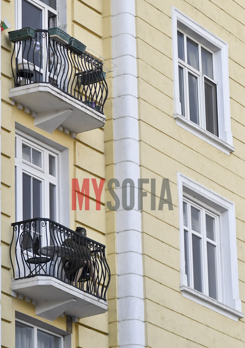 doll-with-gas-mask-resting-on-balcony
